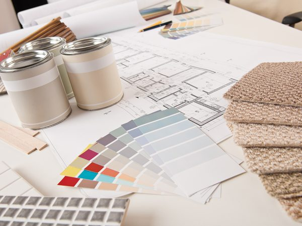 Office of interior designer with paint and color swatch on the desk